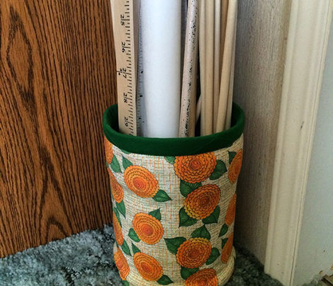 marigolds with green and orange crosshatch background