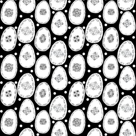 White eggs on black