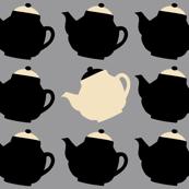 black teapots on grey