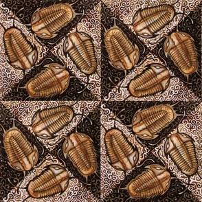 Trilobite Triangles (small dark brown)