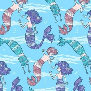 Playful mermaids