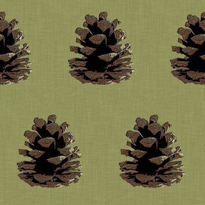 Pinecone on green linen
