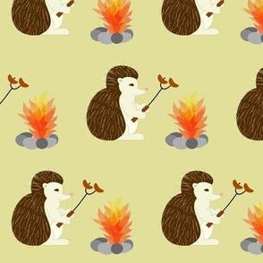hedgehog roasts hot dogs
