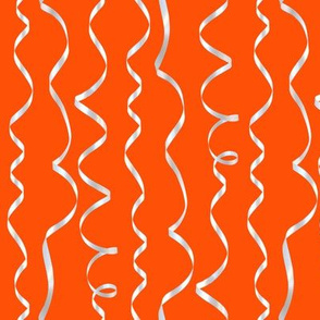 white curling ribbons on red-orange