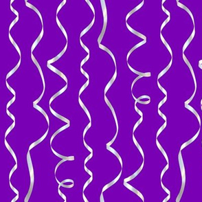 white curling ribbons on purple