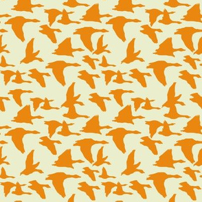birds in flight orange and sage