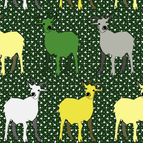 green goat frolics in the falling snow