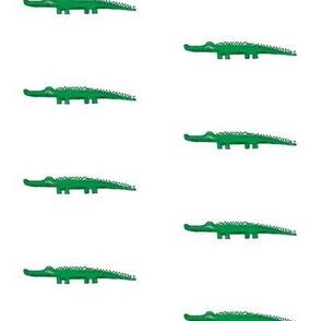 green crocodile with shadow