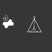 monochrome teepee and fire