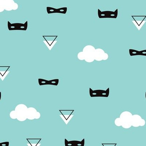 Geometric triangles and kids masks with clouds on blue
