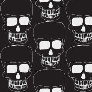 white skull on black