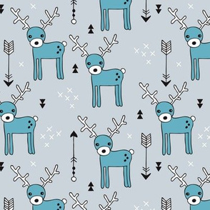 Adorable woodland reindeer and arrows christmas illustration kids pattern design in soft winter blue