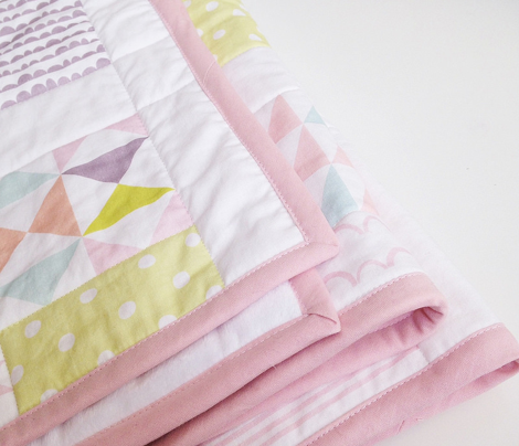 Block border cheater quilt - pastels