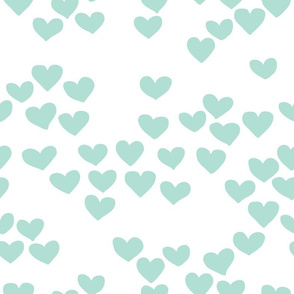 Pastel love hearts tossed hand drawn illustration pattern scandinavian style in soft mint