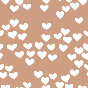 Pastel love hearts tossed hand drawn illustration pattern scandinavian style in soft ochre beige
