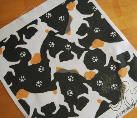 Trotting Russell Terriers and paw prints - black