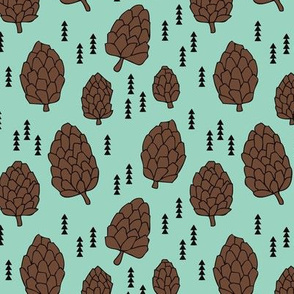 Pine cones winter and fall forest theme in gender neutral mint