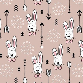 Cool hipster white bunny and geometric arrows spring easter design in gender neutral pastel beige