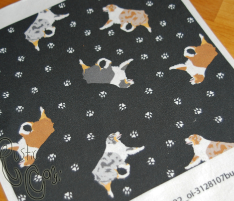 Tiny trotting Australian Shepherds and paw prints - black