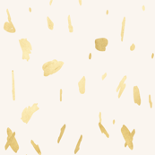 Gold paint blobs on cream