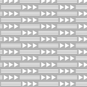 white stripes and triangles on gray