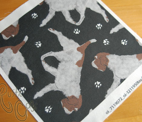 Trotting Wirehaired pointing Griffon and paw prints - black