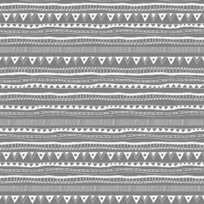 Tribal seamless pattern - chalk tribal signs on gray background