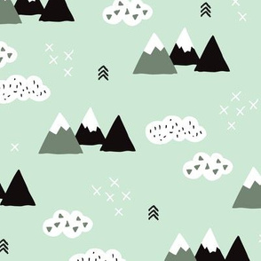 Cool scandinavian winter wonder woodland theme with clouds arrows and mountain peak snow theme vintage gender neutral mint green