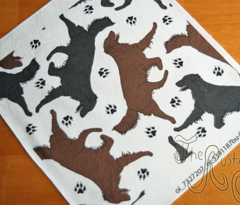 Trotting Flat coated Retrievers and paw prints - white
