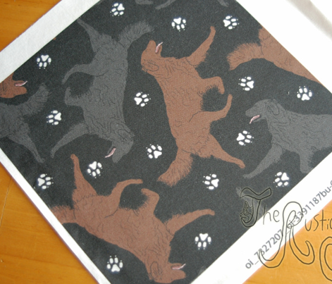 Trotting Flat coated Retrievers and paw prints - black