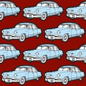 1953 Kaiser light blue on red background