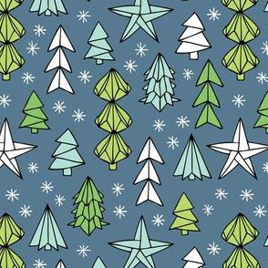 Christmas trees and origami decoration stars seasonal geometric december holiday design green blue night