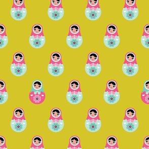 Retro style folklore russian nesting dolls matryoshka babushka mustard pink