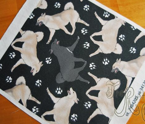 Trotting Norwegian Buhunds and paw prints - black