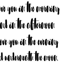 Underneath the moon in black and white font