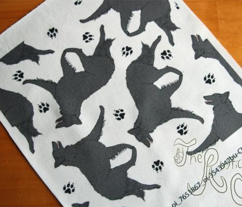 Trotting Belgian Sheepdog and paw prints - white