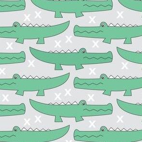 Green gators on grey