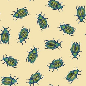 iridescent beetles on cream