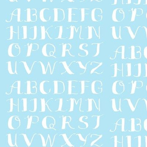 White Calligraphy Alphabet on Light Blue