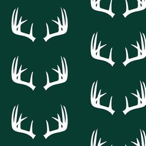 antlers on deep green