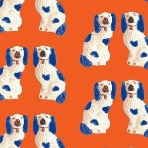 Blue and White Staffordshire Pups on Tangerine Orange
