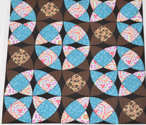 Interlocking Circle Wedge Cheater in Brown Aqua and Pink