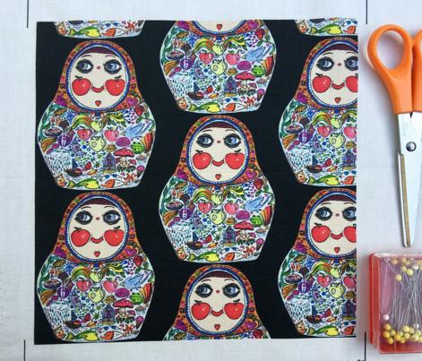 Cheeks Like Apples Matryoshka doll, black background, small scale