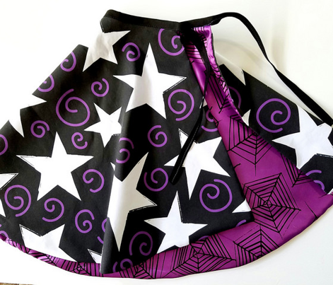 white stars and purple swirls on black