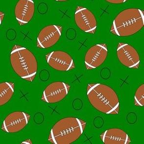 footballs on green