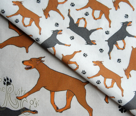 Trotting Doberman Pinschers and paw prints - tiny white