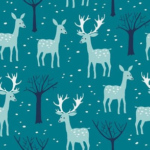 Deers in the winter forest