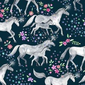 Mom and baby unicorns with stars on dark teal