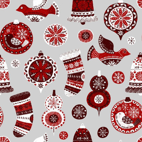 folk christmas ornaments on grey