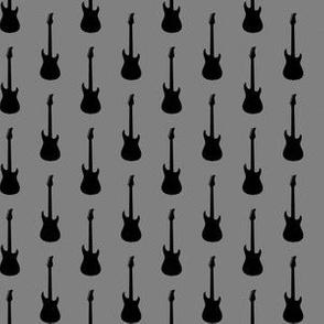 Black Electric Guitars on Medium Gray
